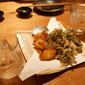 Photos: 菜の花とたまねぎの天ぷらと芋焼酎。